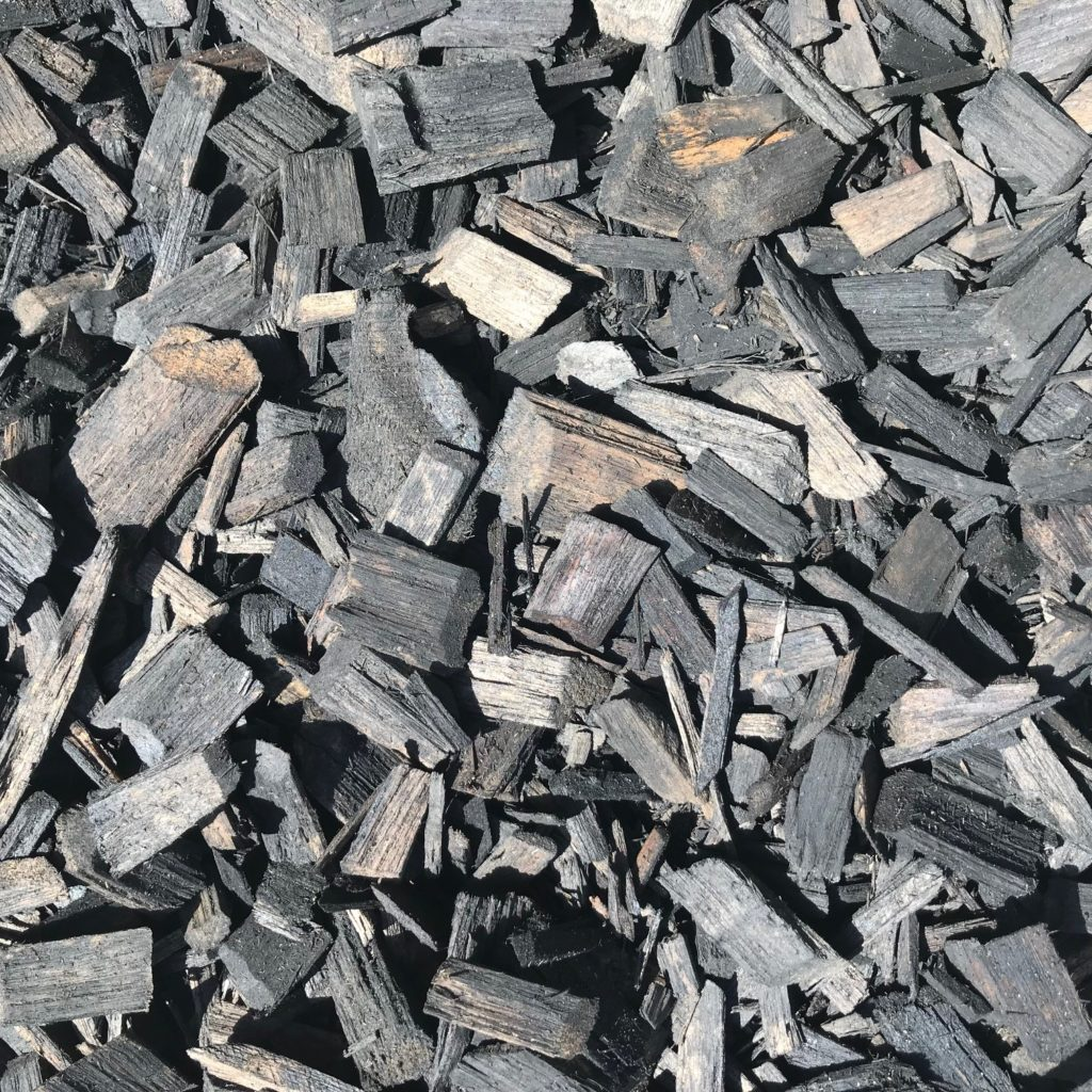 Showing a closeup of black wood chips.