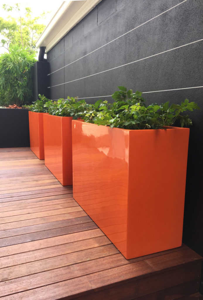 Showing three Auchenflower 60 trough in bright orange.