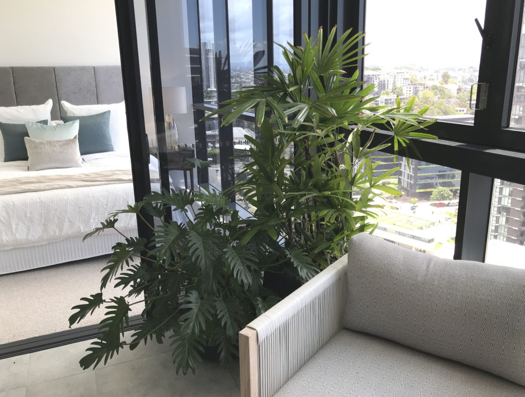 Showing a balcony with a group of Duffel Planters.