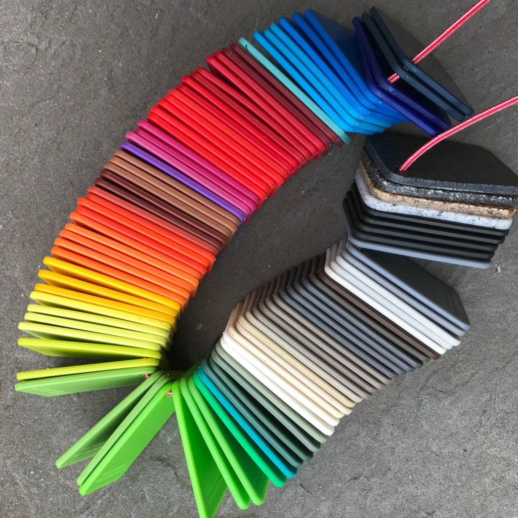 Showing about one hundred colours chits from the available range of colours.
